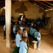 Beginning the public health lesson inside Mogis Primary School