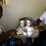 Community Health Nurses Miss Rachel and Miss Pierrette Prepping Multivitamins