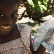 A girl with her medications outside the HFH Infirmary