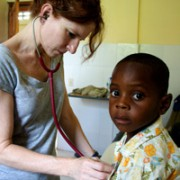 Nurse Connie Wheeler checks out a child