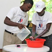 Community Health Workers Demonstrate Proper Hand Washing