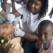 Miss Pierrette distributes Vitamin A at Platon Primary