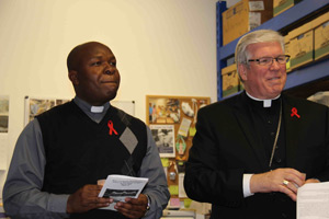 Reverend Benjamin Casimir of Our Lady of Guadalupe Parish in Immokalee and Roman Catholic Bishop Frank J. Dewane of the Diocese of Venice, lead Hope for Haiti in prayer during the Haiti Remembrance Ceremony on January 12, 2011.
