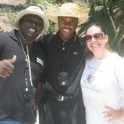 Clerge Gary, buildOn, Father Jude Fils-Aine , and Sarah Dutcher, Hope for Haiti standing on the building site of the new school