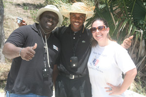 Clerge gary, buildon, father jude fils aine , and sarah dutcher, hope for haiti standing on the building site of the new school