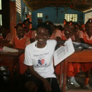 Program Assistant Jessica Jean-Francois with Cherettes 4th grade class in Cherettes chapel