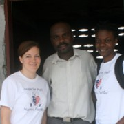 Program Assistants Paula Prince and Jessica Jean-Francois with Father Belizaire, Director of Cherettes Primary School