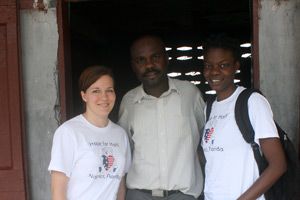 Program assistants paula prince and jessica jean francois with father belizaire, director of cherettes primary school