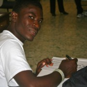 CHW Samuel Terasma smiles as he completes an activity on the symptoms of Anemia