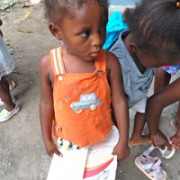 CChild holding her health records as part of follow-up care