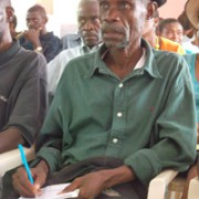 Community Health Worker taking notes at the Baraderes Clinic monthly meeting
