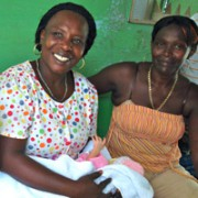 Family members in maternity ward celebrate a new birth