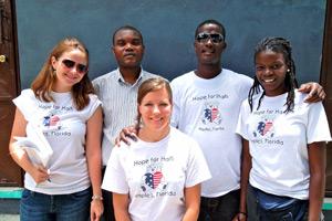 Hope for Haiti staff, Jennifer, Paula, Jessica and Pierre with Dominique Savio's School Director, Father Printemps