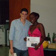 Program Director, Patrick Eucalitto, giving certificate of completion to student Wendie-Alie