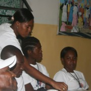 Public Health Nurse Claudine preparing to teach a game activity that identifies infectious diseases