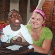 Jen stretching out a young patient at Ile a Vache Orphanage