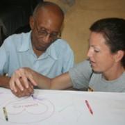 Therapist Karen participates in art activity with Foyer resident