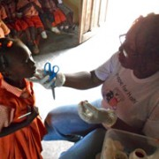 Hope for Haiti's Public Health Nurse, Ms. Pierrette, distributes Vitamin A to a preschooler