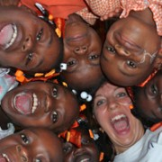 Program Manager, Paula Prince, and students at Cornette Primary School, have some fun with the camera