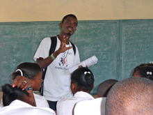 Lucner veillard, community health worker, during a lesson at the st. laurent secondary school