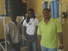 Hope for haiti program manager, jessica jean francois with water technician, harry victor and caretaker of the clinic water system in baraderes, roland jean.
