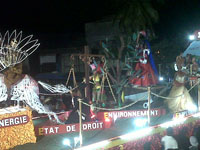 Float passes by in Les Cayes representing the Governmental Ministries.