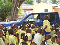 Students at Paul VI gather around the Hope for Haiti truck to dance to Carnival Compa beats.