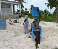 Community members work hard to finish constructing a new school building