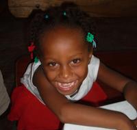 Bethsaida sitting on her school bench.