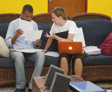 Education Program Manager Paula Prince discusses Hope for Haiti's programs with a school director