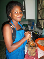 A student prepares seasoning for a chicken
