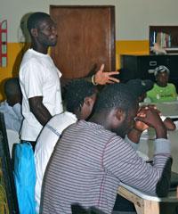 CHW Plesimond Falios describes his cholera intervention to the group.