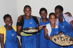 Recent graduates pose with Cooking School Director Carmene