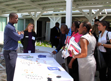 Pierre francois, reforestation program manager, and paula prince, sustainable communities program manager, present hope for haiti's programs to conference attendees