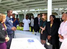 Prime Minister Laurent Lamothe listening to Reforestation Program Officer Pierre Francois as he describes Hope for Haiti's initiatives