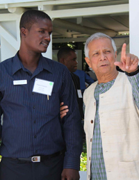 Professor Muhammad Yunus asks Reforestation Program Officer Pierre Francois about the type of seedlings used in Hope for Haiti's Reforestation Program.