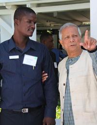 Professor Muhammad Yunus asks Reforestation Program Officer Pierre Francois about the type of seedlings used in Hope for Haiti's Reforestation Program.