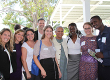 The Hope for Haiti team poses for a photo with Professor Muhammad Yunus after his presentation