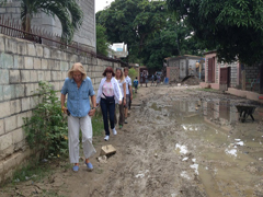 Cathy lost her shoe in the mud as we headed to the school construction site.