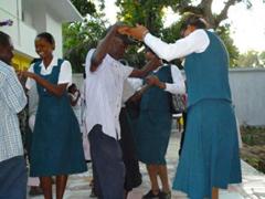 Dancing to traditional Haitian konpa.