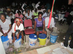 Families receiving Hope for Haiti Emergency Buckets