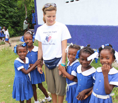 Hope for Haiti staff member, Paula Prince, with students.