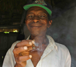 Mr. Silma smokes his homegrown tobacco
