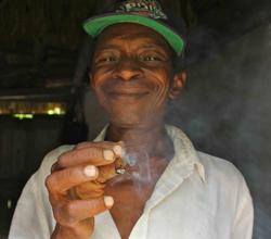 Mr. Silma smokes his homegrown tobacco