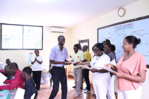 A teacher is happy to receive his certificate of completion!