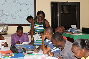 Instructor Emma Francois discusses a group activity with several teachers