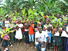 An Agronomist by training, the Education Program Coordinator, Pierre Francois poses with students at another rural school.