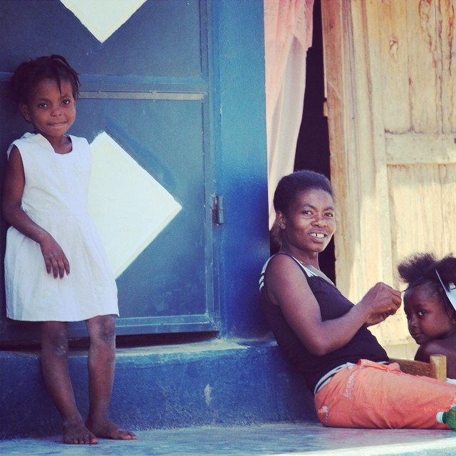 Simple summertime in haiti. a family sits on the stoop of one schools we support and enjoys the calmness; once school is back this will not be possible! #haiti #hopeforhaitifl #connecthealempower #family #education