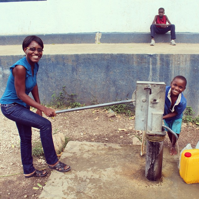 In honor of #worldwaterday our staff help out at one of the taps we installed. this tap serves both the school and community, giving everyone access to clean and delicious tasting #water! #haiti #hopeforhaiti #inthefield