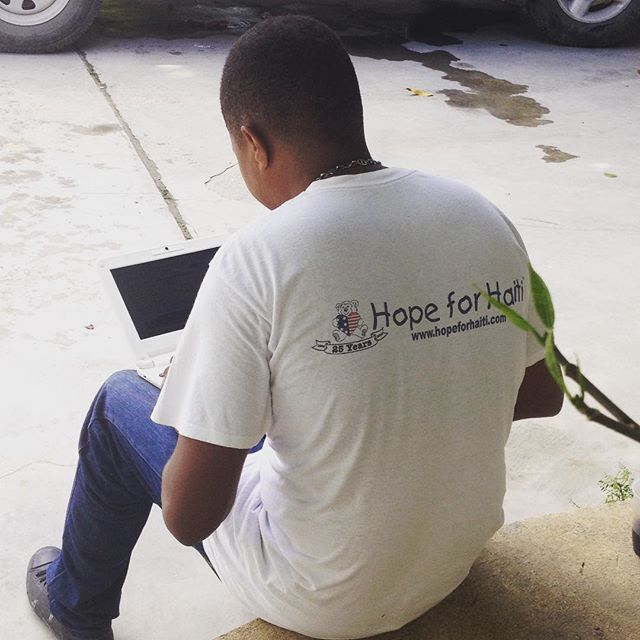 One of our drivers takes a break to check his email on his @endlesscomputers laptop. we gave all of our staff a laptop and in just a few months, we've already seen an increase in computer literacy! #haiti #hopeforhaiti #computer #endless #bonbagay